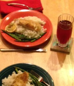 Tilapia, rice, asparagus. A glass of juice. Nothing more is required.