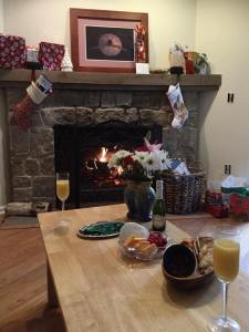 A tiny tree, some cheese and crackers, a snickerdoodle, and a mimosa by the fireside: maybe the most perfect Christmas luncheon ever.