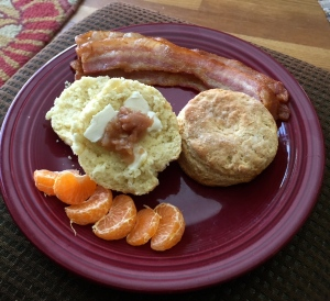 The bacon was pronounced good, too.  And her apple butter, on that biscuit half, is pretty superb.  (Sadly, the steam rising from the biscuit when it was split did not photograph well.)
