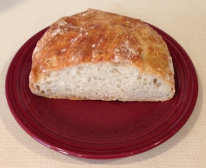 No-Knead Bread, the next morning, after a slice for a snack and preparing an egg-and-cheese sandwich for her breakfast.